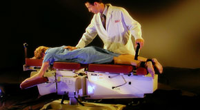 This is a picture of Cox Technic chiropratic spinal manipulation as performed at Gormish Chiropractic & Rehabilitation.